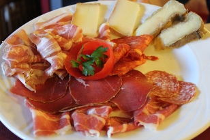 Mixed plate of cured meats and cheese