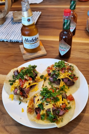 Skirt steak tacos on another.